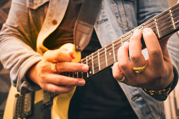 a man playing the guitar with happiness and fun.