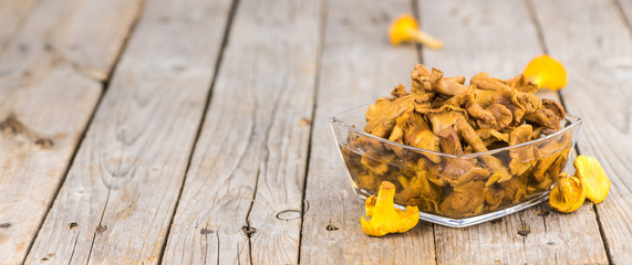 Wooden table with Canned chanterelles, selective focus