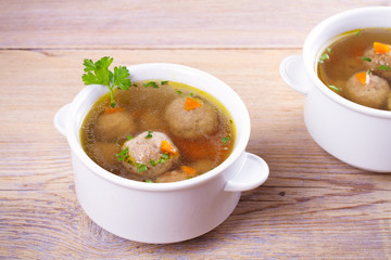 Broth with meatballs. Meatball soup