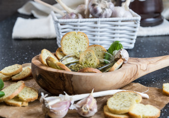 Crispy home-made basil bruschetta with basil pesto
