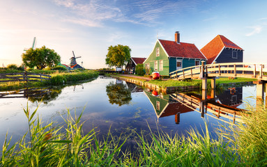 Traditional dutch windmill near the canal. Netherlands, Landcape at sunset Fototapete