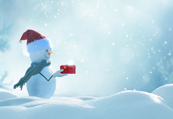 Wall Mural - Merry christmas and happy new year greeting card . Happy snowman  standing in winter christmas landscape.