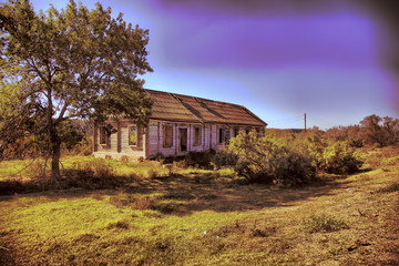 An old abandoned wooden house with walls made of straw. Astrakhan region. Russia.