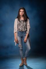 beautiful young brunette girl posing in dress