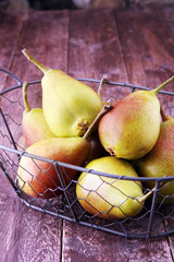 Fresh ripe organic pears on rustic wooden table, natural background, vega, diet food.
