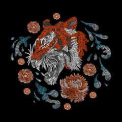tiger and roses, orange. traditional stylish fashionable floral embroidery on the black background. sketch for printing on clothing, fabric, bag, accessories and design