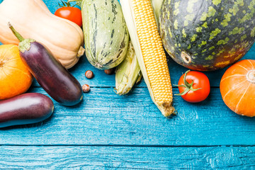 Tinted photo of blue wooden table with autumn vegetables