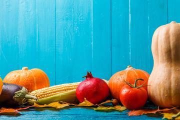 Picture of pumpkin, tomato, pomegranate, autumn leafs