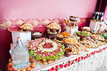 Cheese and meat decorated dishes on the wedding banquet.