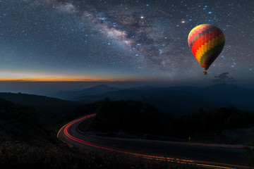 Printed roller blinds Balloon Hot air balloon flying over Chiang Mai Viewpoint Thailand under the sky with milky way and shininng star at night (with grain)