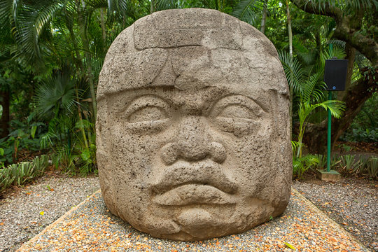 large pre-hispanic olmec basalt carved head in the La Venta archeological park in Villahermosa Mexico