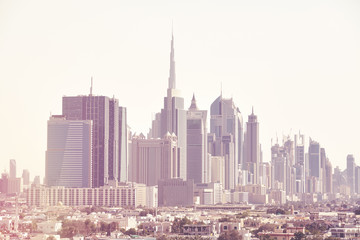 Color toned picture of Dubai skyline, United Arab Emirates.