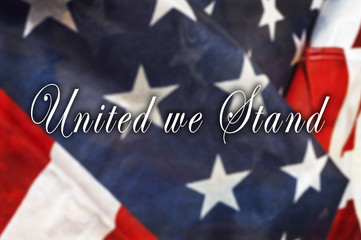 United we Stand message on  USA flag.