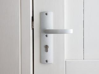 White door with chrome doorhandle