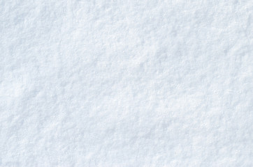 Background of fresh snow texture in blue tone. Copyspace for text