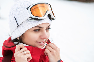 Portrait of a skier woman in ski goggles