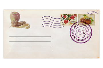 Post envelope with postage stamps and prints. Pomegranates, apples and honey are traditional holiday symbols of  Rosh Hashana - Jewish new year.  Old paper. Vintage style