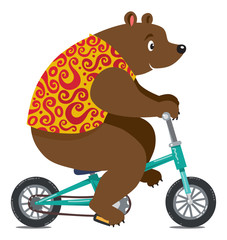 Funny circus bear on bicycle