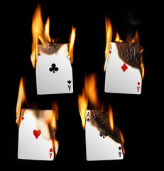Real Burning Playing Cards with red hot Flames Isolated on Black Background: Aces