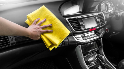 Microfiber and console car, Hand cleaning Interior modern car, Microfiber and cleaning solution to clean, copy space.