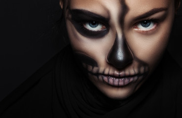 Closeup girl face with make-up skeleton. Halloween portrait.
