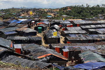 Temporary healthcare centers, where the oral cholera vaccine provided by WHO is administered, are seen marked with yellow flags in the Jamtoli refugee camp in Cox's Bazar