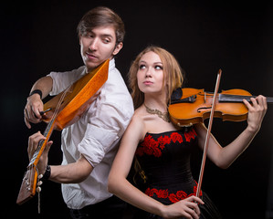 Musical couple with fiddle and balalaika