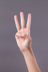 hand showing, pointing up 3 fingers, number three hand gesture
