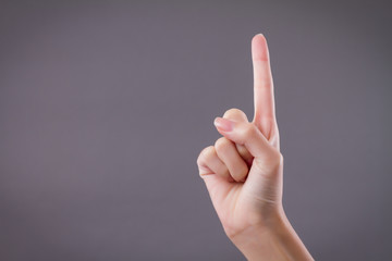 hand showing, pointing up 1 fingers, number one hand gesture