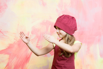 Girl in chef hat and apron with karate hand gesture