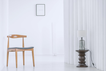 Wooden chair in bright hall