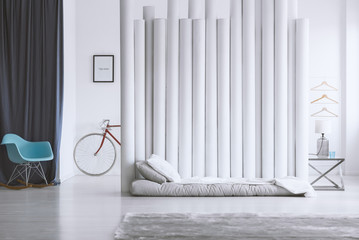 Gray bed and tube divider