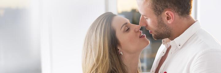Woman kissing man