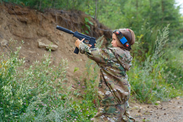 Young boy with gun, laser tag, war simulation