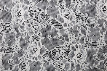 white floral lace on a black background