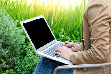businesswoman do business use computer out of the office