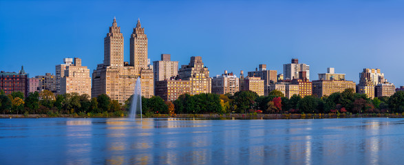 Central Park West and the Jacqueline Kennedy Onassis Reservoir at dawn (panoramic). Upper West Side, Manhattan, New York City