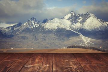 Fotoväggar - Table on winter mountains background