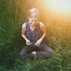 Beautiful Girl Laughing in the Grass