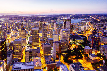 Aerial view of downtown Seattle with Space Needle with beautiful sunset at night