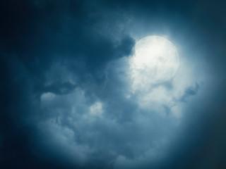 Full moon on a cloudy sky