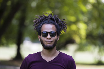 portrait of young happy african man with sunglasses