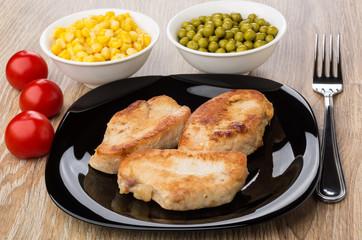 Fried turkey meat in plate, tomato, sweet corn, green peas