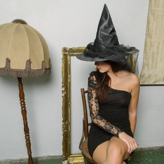 Attractive Brunette Wearing Witch Costume for Halloween