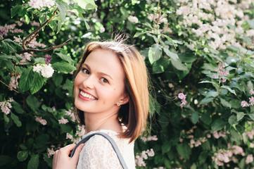Happy young woman looking at camera