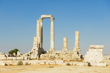 Ancient stone columns at the Citadel of Amman with the blue sky at the background in Amman, Jordan.