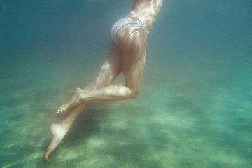long legs in the sea underwater