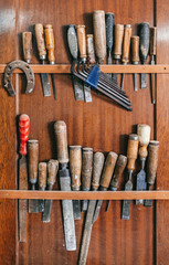 Old Carpenter Tools on a Wooden Wall
