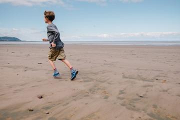 Child running on wet sand