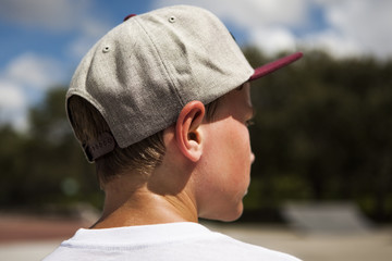 Boy in Baseball Cap from the side